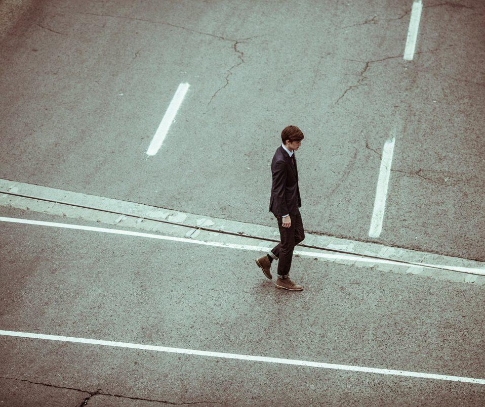 man alone on street