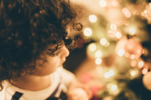 child looking at ornaments