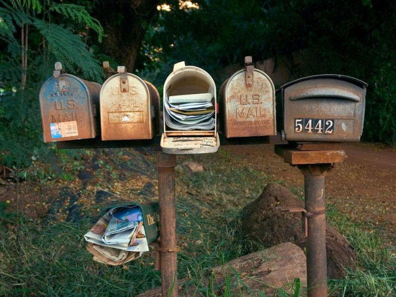 mailboxes on wooden posts